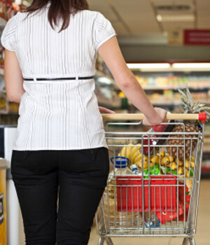 Woman walking through grocery store