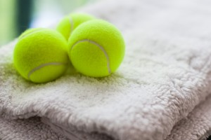 Tennis balls on top of a fluffy white rug
